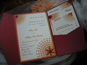 Sassy Sunburst wedding invitation in Burgundy and Orange