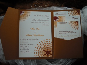 Sassy Sunburst Wedding Invitation in Copper, Orange and Burgundy